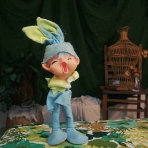 Adorable singing elf dressed up as an Easter bunny